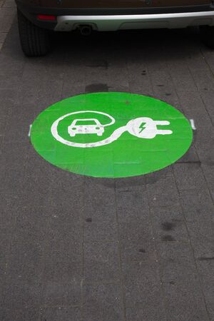 electric cars: Sign for charging station for electric cars on asphalt Stock Photo