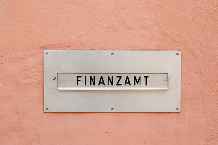 The german word for tax office (Finanzamt) on a letter box Stock Photo - 63287630