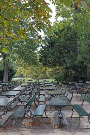 darken: Tables and chairs in a public park