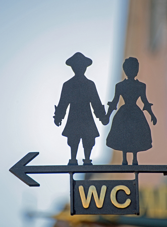 sign: Sign WC with stylized man and woman