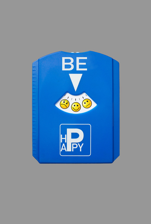 symbolics: A german parking disc with the words be happy, isolated on grey