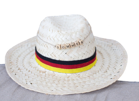 straw hat germany and sand with german text for summer, isolated on white