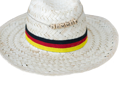 straw hat germany with german text for summer, isolated on white
