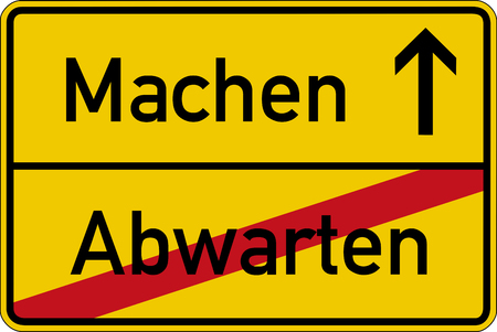 The German words for wait and make (abwarten and machen) on a road sign