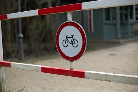 German metal sign on a barrier which means bicycles forbidden