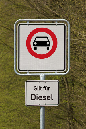 German traffic sign  for diesel driving prohibited with german text for applies to diesel, isolated on white Standard-Bild - 104347648