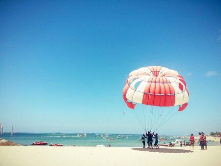 Fun Parasailing at a White Sand Beach