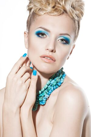 Beautiful sexy young woman with turquoise makeup and photo