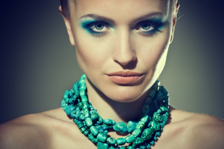 motton blue: Beautiful sexy young woman with turquoise makeup and