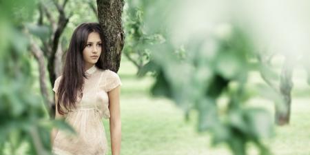 Beautiful girl in a wild garden Stock Photo - 16227860