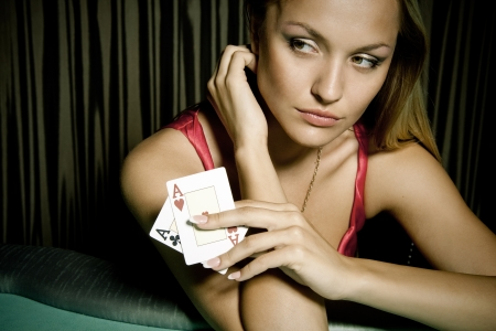 poker cards: Sexy young girl in casino Stock Photo