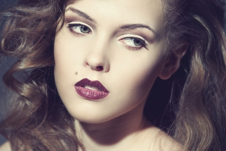 Closeup portrait of a sexy young caucasian woman with red lips photo