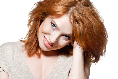 Closeup portrait of a sexy young woman with red hair and natural makeup photo