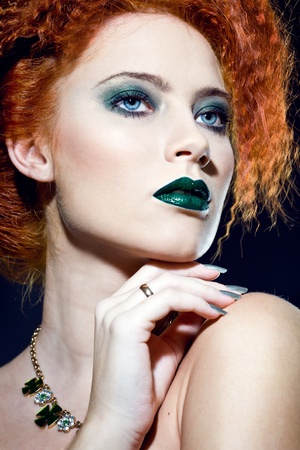 Closeup fashion portrait of a beautiful woman with creative makeup photo