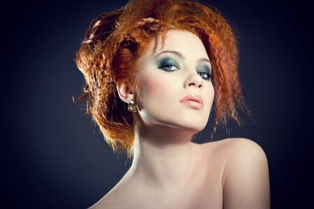 Face of a beautiful redhead woman with perfect makeup photo
