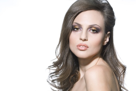 Studio portrait of a beautiful sexy brunette woman with perfect makeup photo