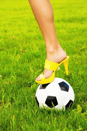 Soccer ball and high heel photo