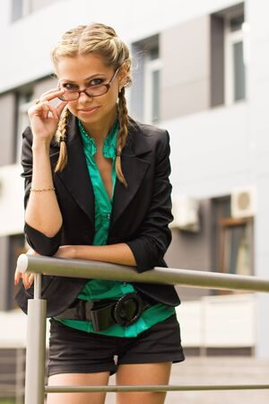 A beautiful young business woman wearing glasses Stock Photo - 16231546