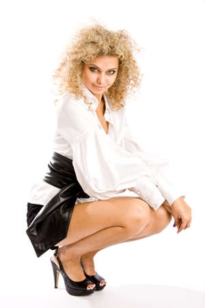 long legs: Fashion model isolated on white background