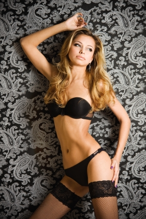 Young, beautiful sexy blonde woman in black lingerie