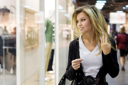 Young blond woman shopping photo