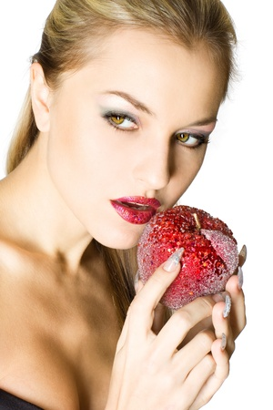 Closeup studio portrait of beautiful sexy young woman with red apple, isolated on white background photo