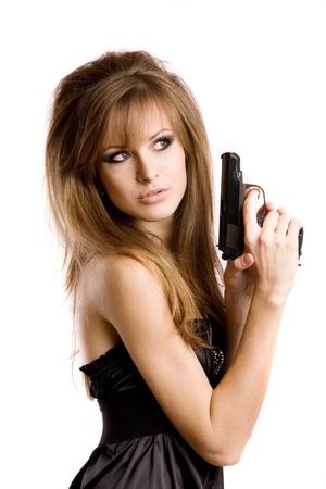 mujer con arma: Una ni�a con una pistola