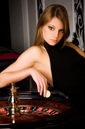roulette table: Sexy young girl in casino Stock Photo