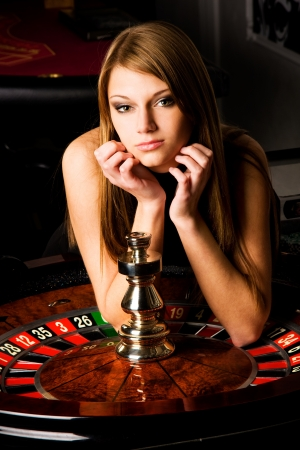 roulette wheel: Sexy young girl in casino Stock Photo