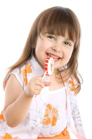 Adorable little girl with a candy photo