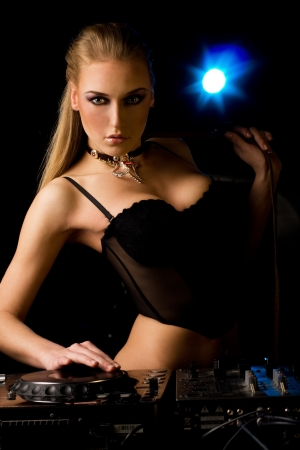 Beautiful DJ girl in the nigh club photo