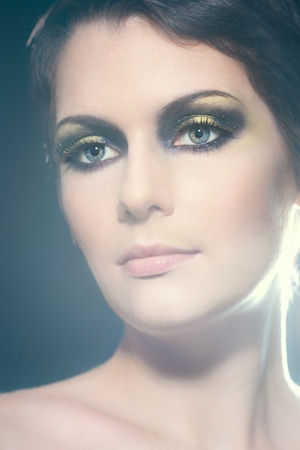 Closeup portrait of a sexy young brunette woman with bright makeup and gorgeous eyes photo