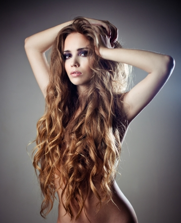sexy topless girl: Sexy young woman with beautiful long curly hair Stock Photo