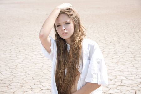 Beautiful girl in a desert photo