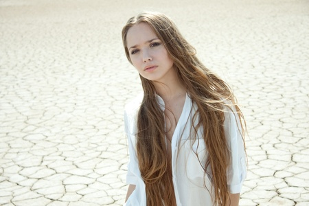 extreme heat: Beautiful girl in a desert