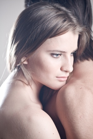 fair skin: Beautiful young woman leaning to a mans shoulder