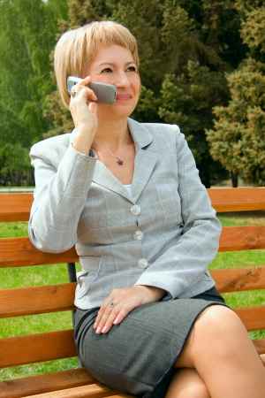 Middle-aged businesswoman in a park Stock Photo - 16271116