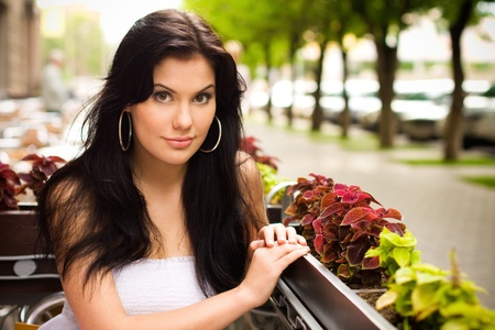 Young woman in a cafe outdoors Stock Photo - 16301029
