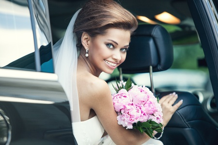 bridal bouquet: Beautiful happy young bride