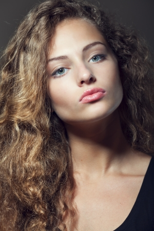 Beautiful sexy young woman with curly hair Stock Photo