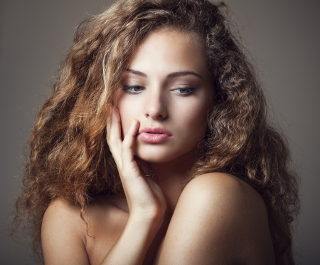 Beautiful sexy young woman with curly hair photo