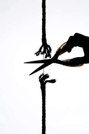 silouette: cutting a rope with a knife