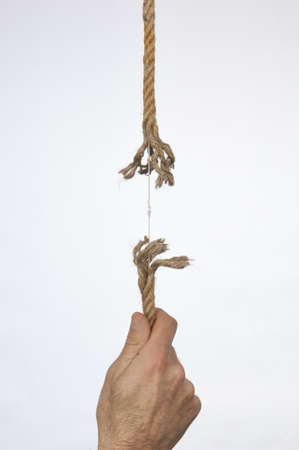 Frayed rope pulled by hand