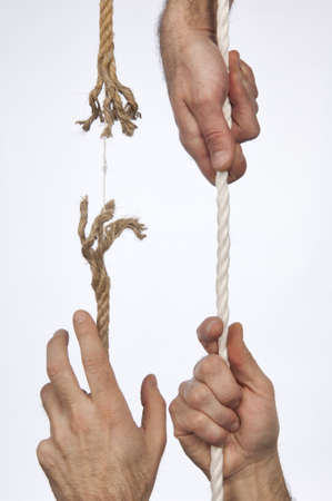 frayed: Frayed rope pulled by hand