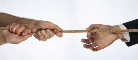 Hands that do tug of war photo
