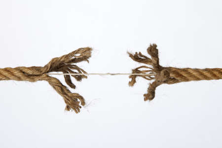 tug of war: Frayed rope on a white background