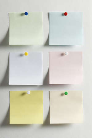 Blank paper, hanging on the wall with a colored pushpin Banco de Imagens - 12881917