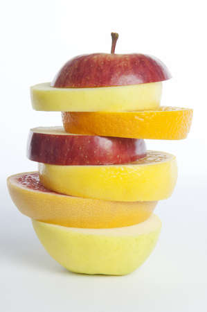 cholesterol free: sliced apples and  oranges stacked Stock Photo