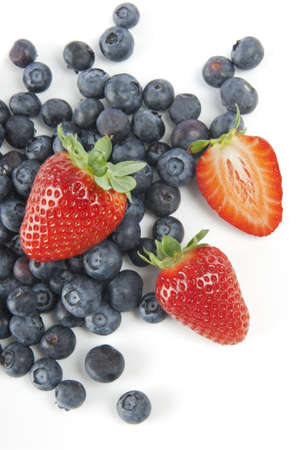 colourful images: Blueberries and strawberries on a white background