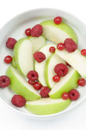 cholesterol free: Mixed Berries and apples in a white cup